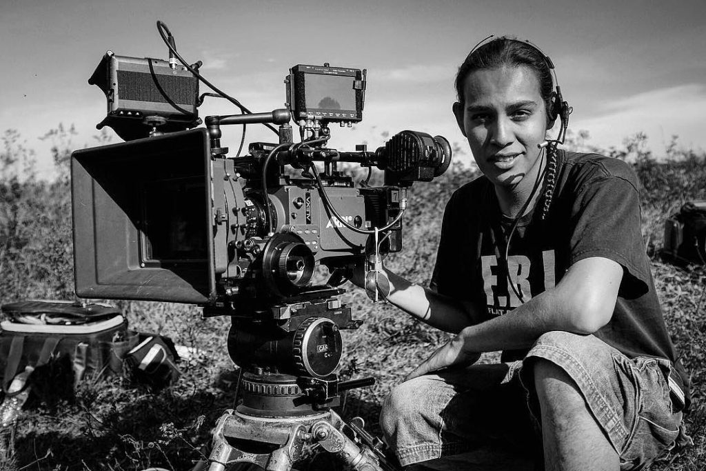 """This is Lindsay Sarazin, Algonquin/Ojibwe photographer and filmmaker. The lead artist behind the mini-documentary called  """"Miinjiminaatah Anishinaabemowin."""" To be released this Sunday in celebration of National Indigenous History Month.   """"Miinjiminaatah Anishinaabemowin"""" celebrates the vitality of Anishinaabemowin, the Ojibwe language still spoken by virtually everyone in Pikangikum First Nation in northern Ontario, Canada.   Created in honour of the International Year of Indigenous Languages declared by the United Nations in 2019, this film strides """"…to raise awareness—not only to benefit the people who speak the languages—but also for others to appreciate the important contribution they make to our world's rich cultural diversity.""""  In 2019, ArtsCan Circle sent a team of artists to Pikangikum First Nation to work with the community on storyboarding, mentoring and filming. Capturing the raw beauty of Pikangikum over two weeks, filmmaker, producer and lead artist Lindsey Sarazin, Mathieu Taillefer (Camera Operator), and community members Lily Kejick, Randy Dunsford, and Margaret Lawson to create this community vision of speaking their Ojibwe language and passing it on to the next generation.  This project was funded by @td_canada   #lindsaysarazin #indigenousfilmmaker #indigenousphotographer #pikangikum #objibwelanguage #nationalindigenoushistorymonth #internationalyearofindigenouslanguages #artscancircle #minidocumentary #indigenouslanguage #wolfeyeproductions"""